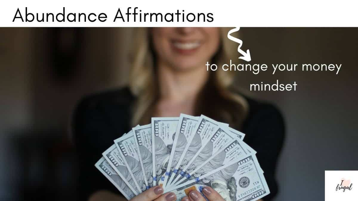 Abundance Affirmations to Change Your Money Mindset - Woman holding money in hands, learn how to transform your money mindset using these money affirmations.